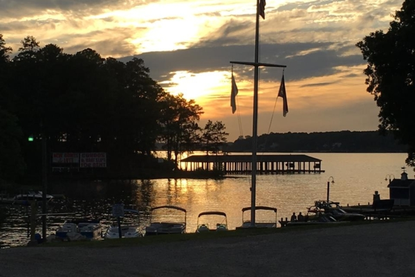 Contest winning photo of a sunset over the water with a flag