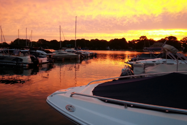 Sun setting over Lake Norman and boats at Morningstar Marinas Kings Point