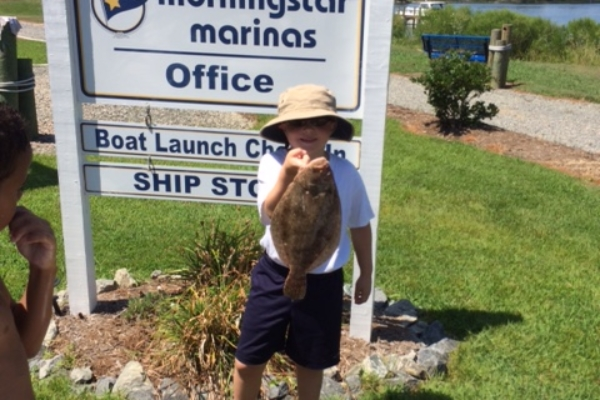 Child with large Flounder catch