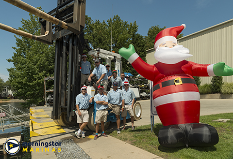 Morningstar Marinas Kings Point staff members posing with Santa for Christmas in July