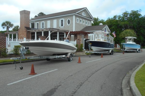 Show boats lined in front of the Reserve Harbor Yacht Club clubhouse