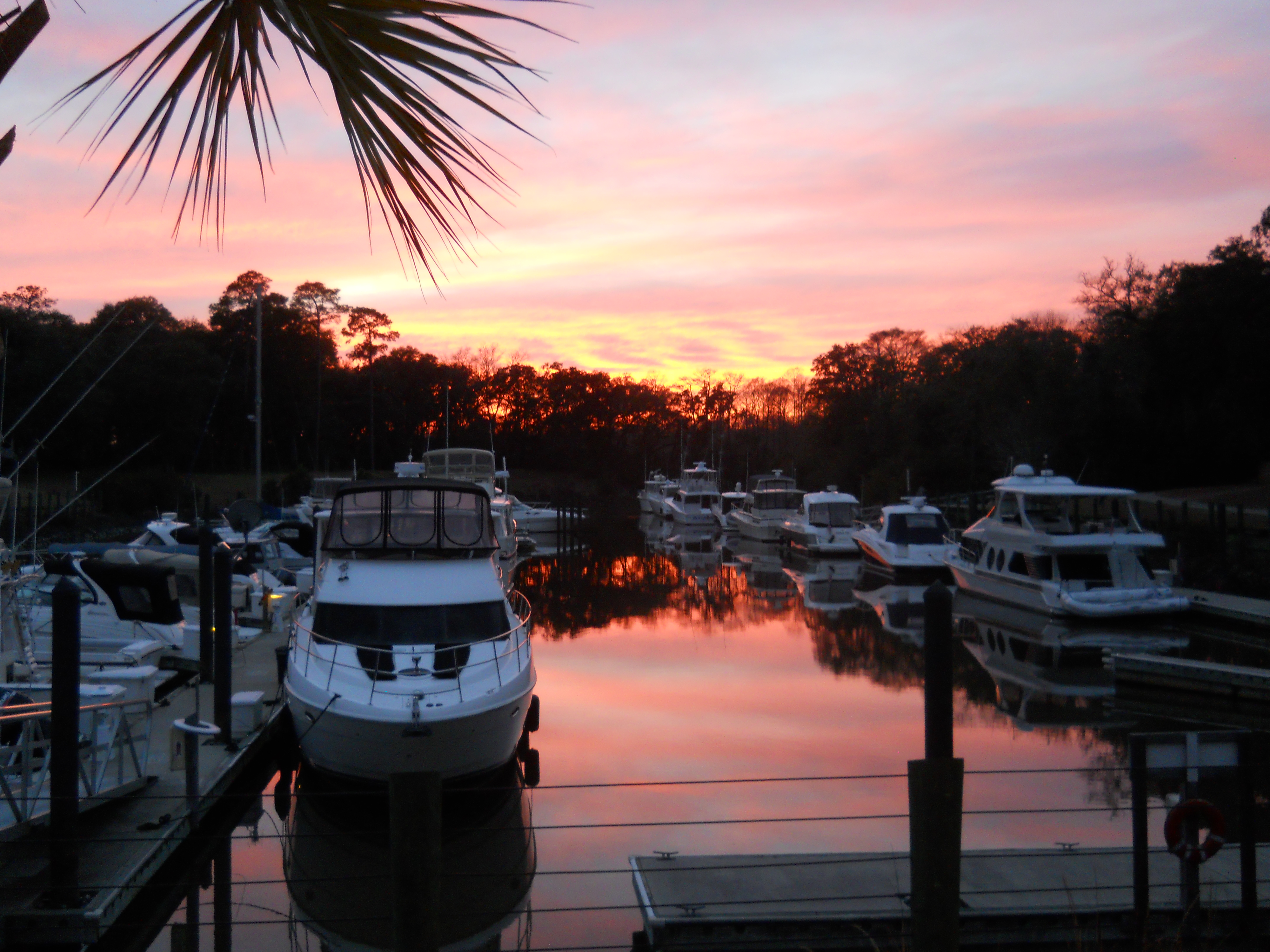 Sun setting over the water and boats at Reserve Harbor Yacht Club