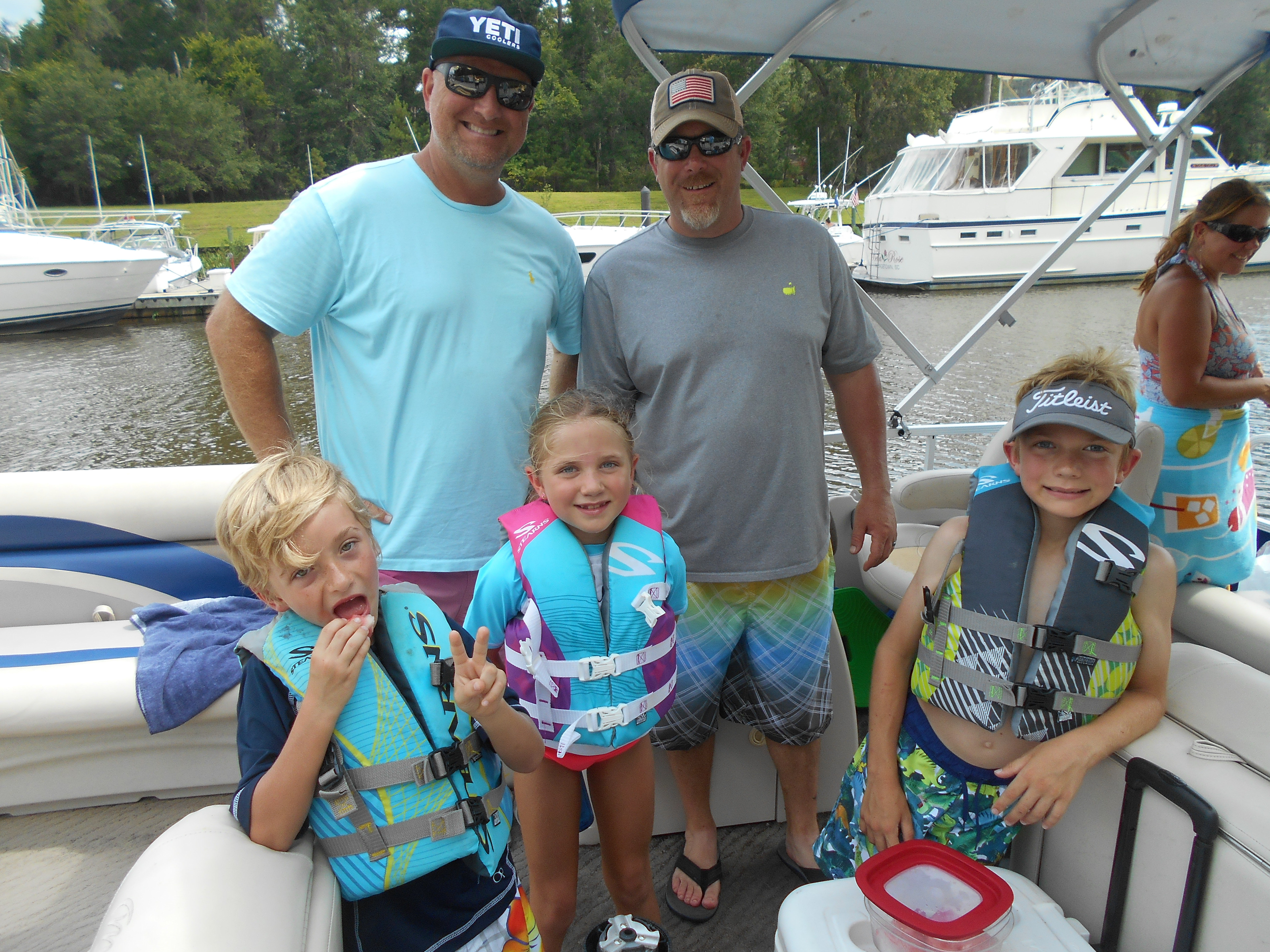 Family on their boat at Reserve Harbor Yacht Club