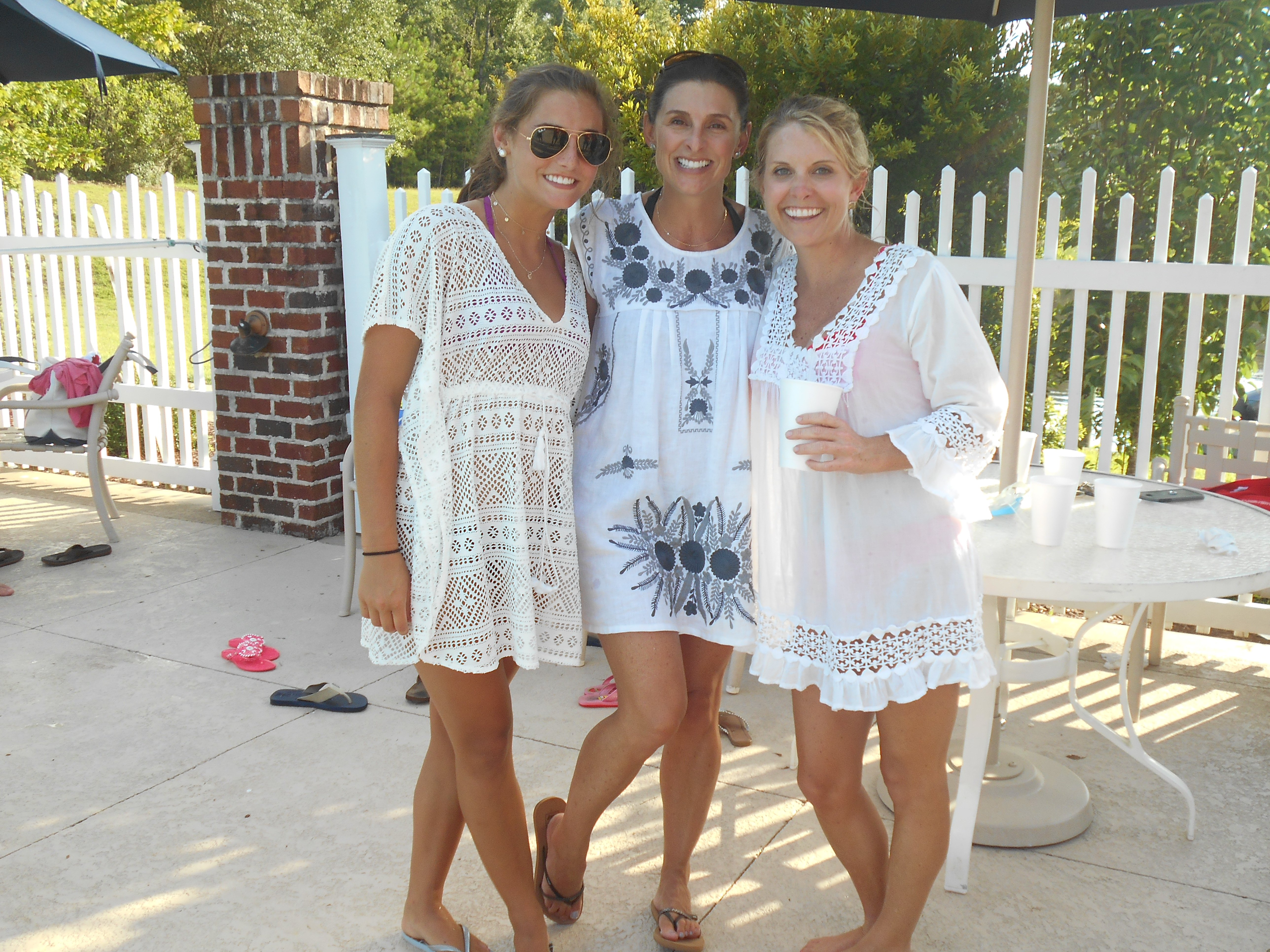Members pose by the pool at Reserve Harbor Yacht Club