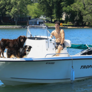Dogs on Boat with Owner