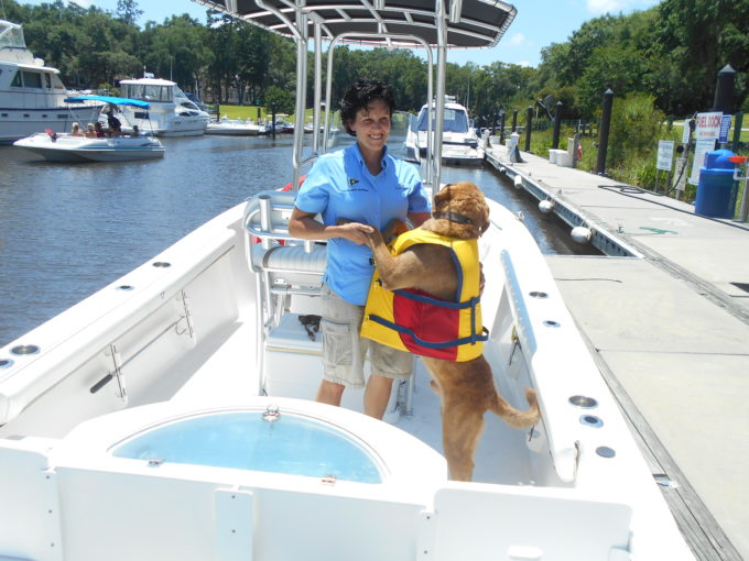 Dog Hugging Woman on Boat