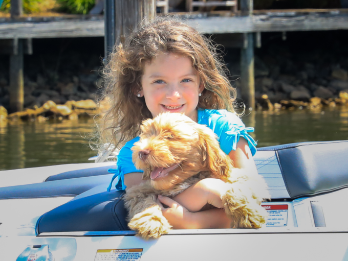 Girl with dog on boat
